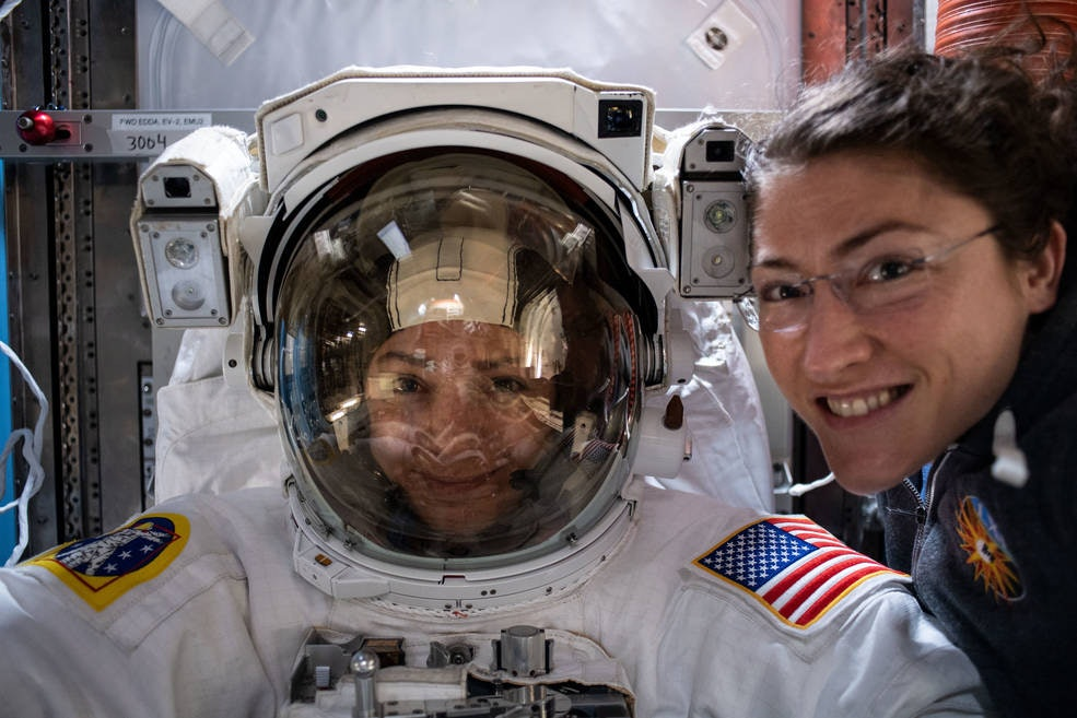 NASA astronauts Jessica Meir (left) and Christina Koch prepare on the International Space Station for the first all-female spacewalk.