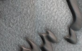 Martian sand dunes and boulder piles.