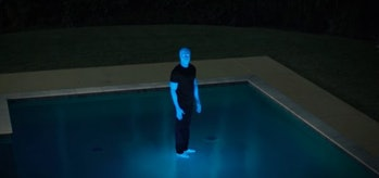 Doctor Manhattan walks on water.