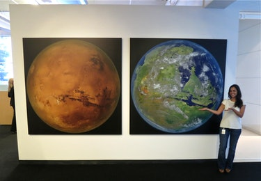 SpaceX's front entrance lobby shows a large picture of Mars, next to an image of a hypothetical terraformed Mars.