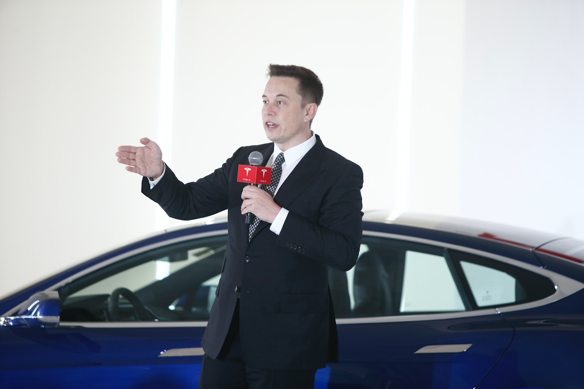 BEIJING, CHINA - OCTOBER 23: (CHINA OUT) Elon Musk, Chairman, CEO and Product Architect of Tesla Motors, addresses a press conference to declare that the Tesla Motors releases v7.0 System in China on a limited basis for its Model S, which will enable self-driving features such as Autosteer for a select group of beta testers on October 23,2015in Beijing, China. The v7.0 system includes Autosteer, a new Autopilot feature. While it's not absolutely self-driving and the driver stillneedto hold the steering wheel and be mindful of road conditions and surrounding traffic when using Autosteer. When set to the new Autosteer mode, graphics on the driver's display will show the path the Model S is following, post the current speed limit and indicate if a car is in front of the Tesla. (Photo by VCG/VCG via Getty Images)