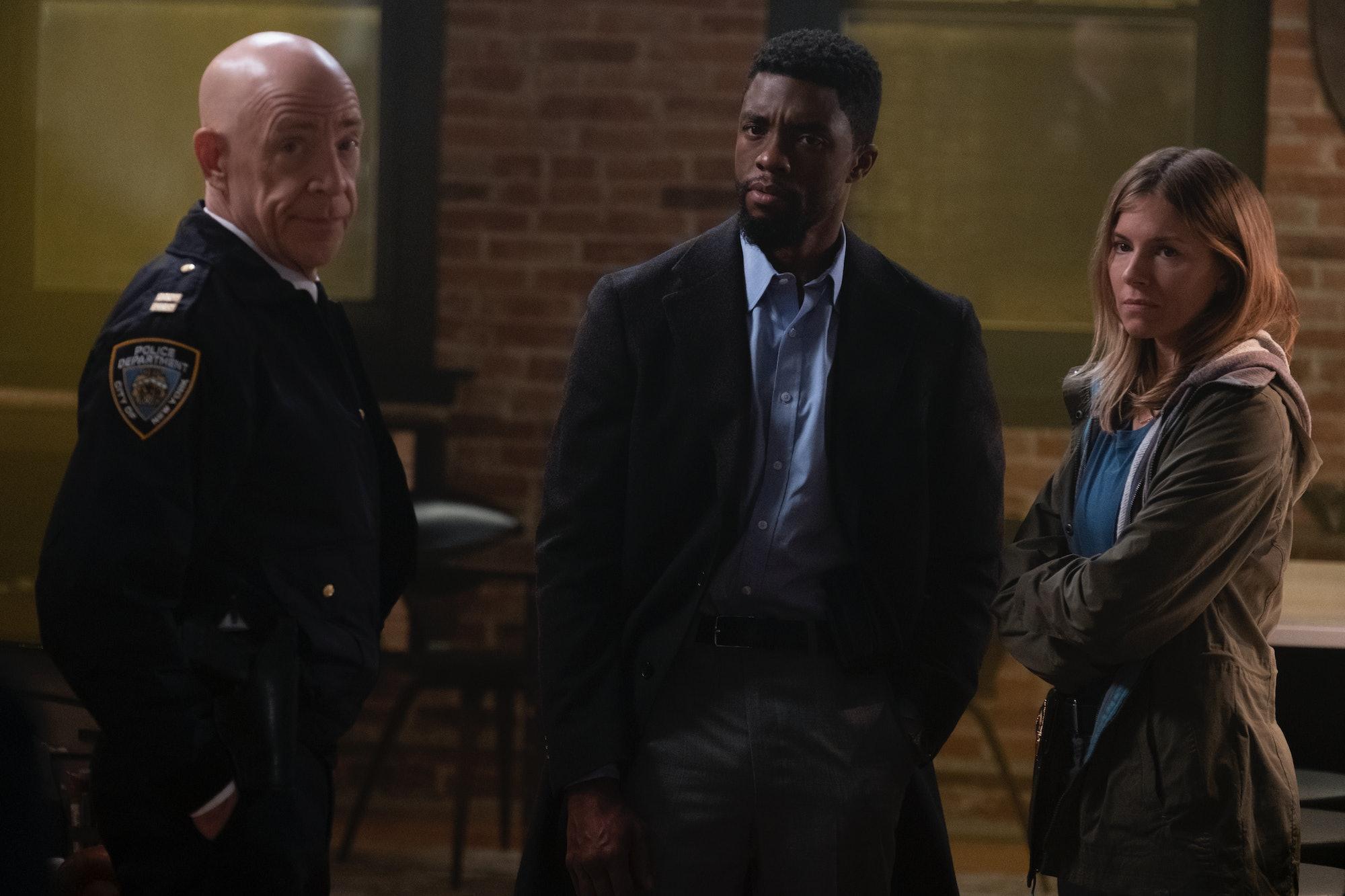 '21 Bridges' review stars J.K., Simmons, Chadwick Boseman, and Sienna Miller.