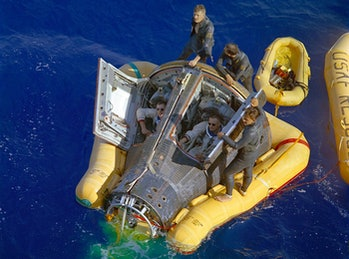 Recovery of Gemini 8 from the western Pacific Ocean; Armstrong sitting to the right