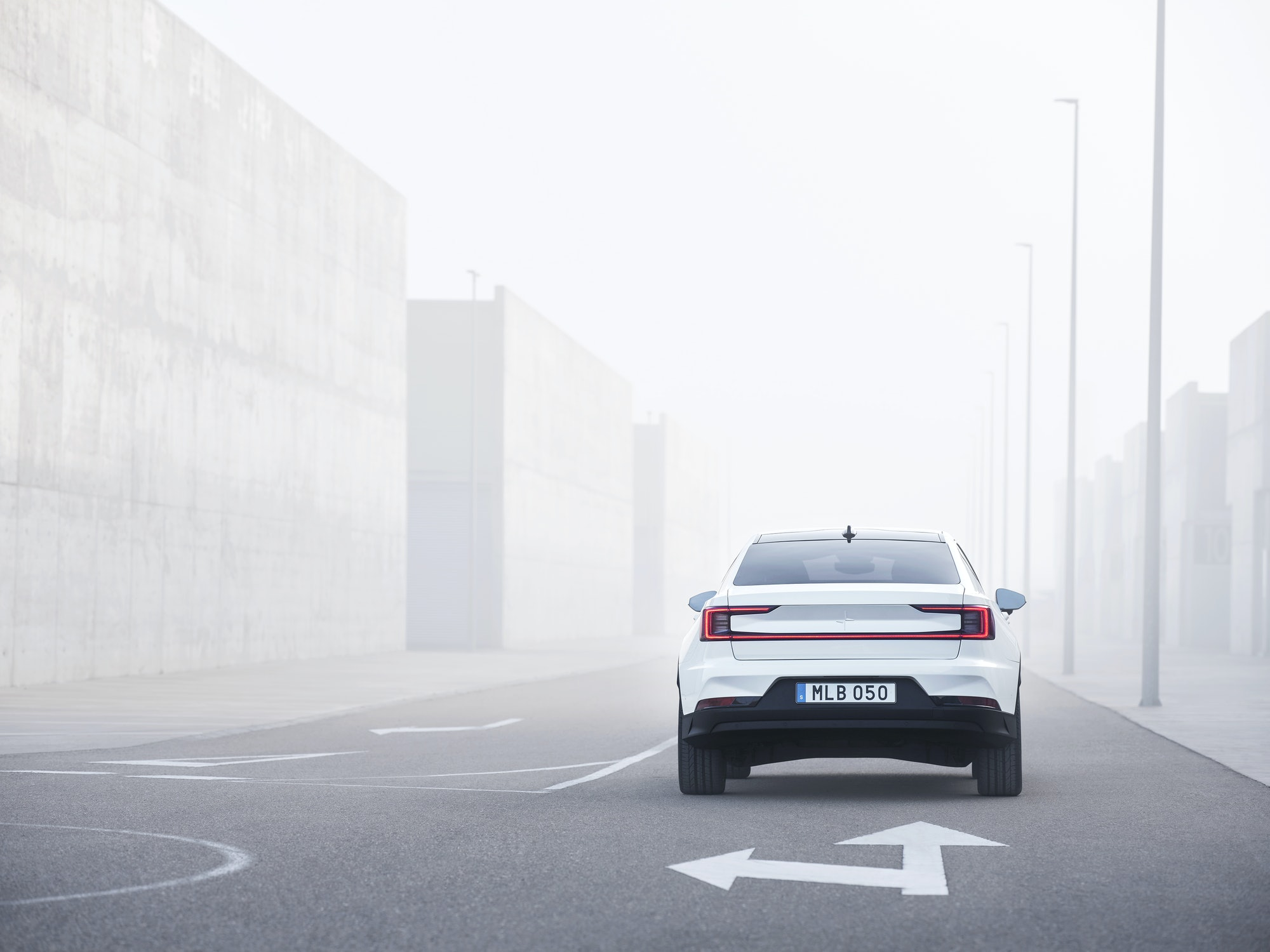 Polestar 2 driving down the road.