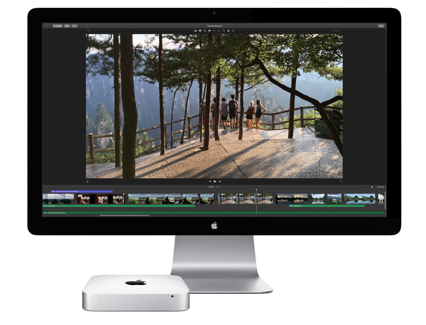 Mac Mini alongside an Apple display.