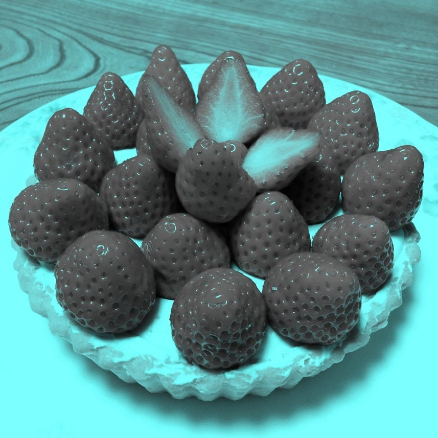 These strawberries are all gray. Your brain just doesn't like that.