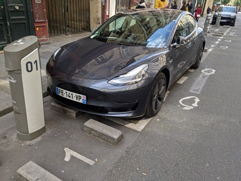 A Tesla Model 3 parked in an electric vehicle parking spot in Paris in April, 2019.