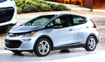 The all-electric Chevrolet Bolt EV is shown on stage after it won the Car of the Year Award at the 2017 North American International Auto Show on January 9, 2017 in Detroit, Michigan.