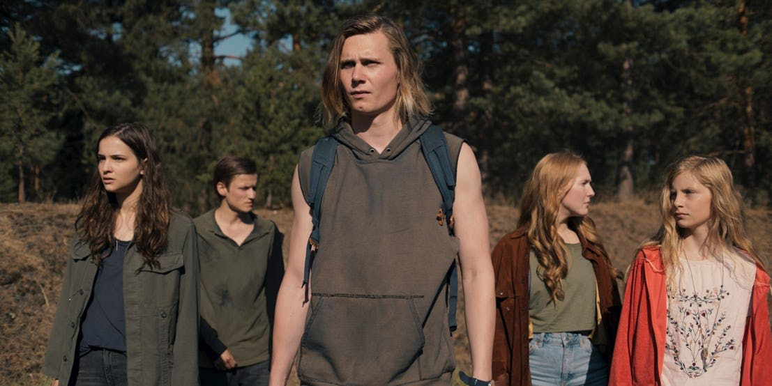 The cast of Netflix's Dark in a still showing them traveling from 2020 to 1987
