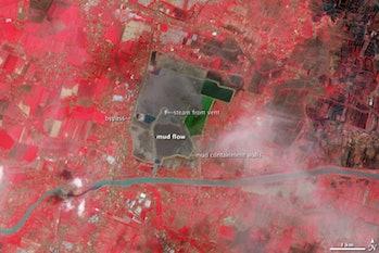 NASA color image Lusi Indonesia mud spread city damage