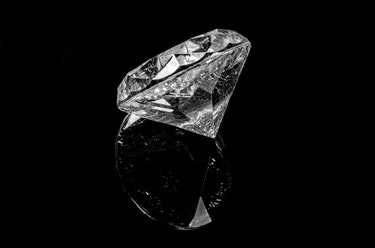 Diamond anvils are used to crush hydrogen atoms at extremely high pressure.