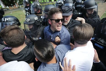 Spencer and his supporters clash with Virginia State Police in Emancipation Park after the 'Unite th...