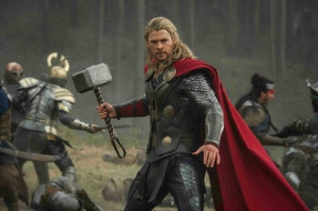 Thor brandishing his hammer in the middle of battle in 'Thor: The Dark World.'