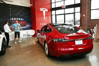 NEW YORK, NY - JULY 05: A TeslamodelS sits parked in a new Tesla showroom and service center in Red Hook, Brooklyn on July 5,2016in New York City. The electric car company and its CEO and founder Elon Musk have come under increasing scrutiny following a crash of one of its electric cars while using the controversial autopilot service. Joshua Brown crashed and died in Florida on May 7 in a Tesla car that was operating on autopilot, which means that Brown's hands were not on the steering wheel. (Photo by Spencer Platt/Getty Images)