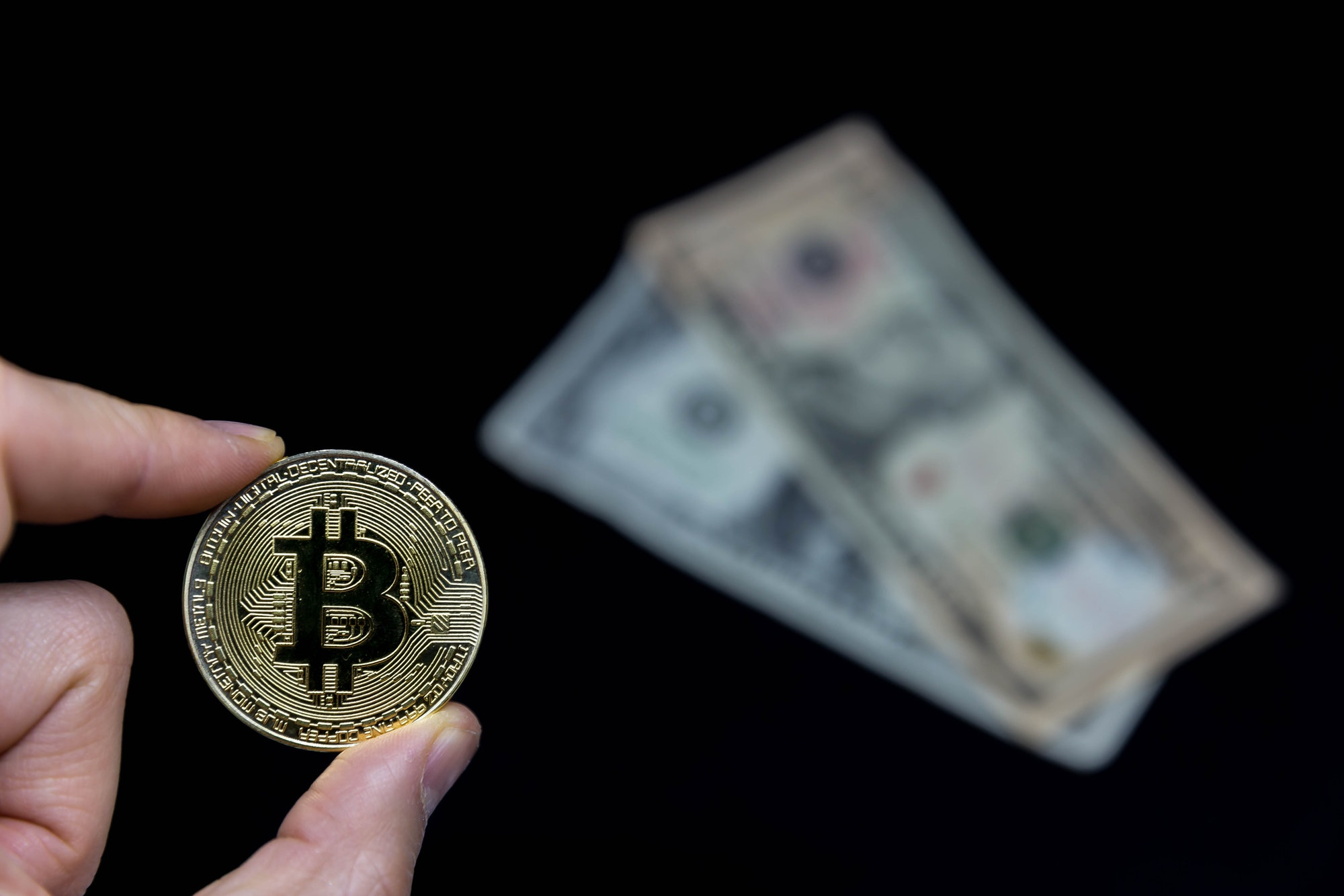Bitcoin with Dollar in Background