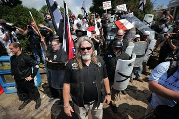 CHARLOTTESVILLE, VA - AUGUST 12: White nationalists, neo-Nazis and members of the 'alt-right' exchange insluts with counter-protesters as they attempt to guard the entrance to Emancipation Park during the 'Unite the Right' rally August 12, 2017 in Charlottesville, Virginia. After clashes with anti-fascist protesters and police the rally was declared an unlawful gathering and people were forced out of Emancipation Park, where a statue of Confederate General Robert E. Lee is slated to be removed. (Photo by Chip Somodevilla/Getty Images)