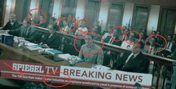 Multiple clones of Sam Bell (Sam Rockwell) from 'Moon' in a news broadcast seen briefly in 'Mute'