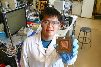 Coauthor Fengwang Li (above) demonstrates the copper-based catalyst that the team designed for CO2 conversion.