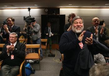 WASHINGTON, DC - FEBRUARY 26: Apple Co-Founder Steve Wozniak (R) applauds after the Federal Communic...
