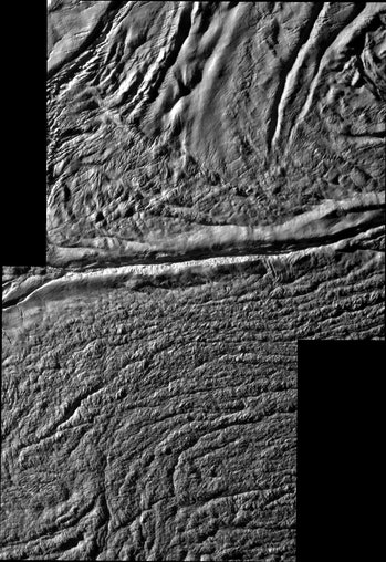 A close-up view of the crevices that formed on the surface of Saturn's icy moon.