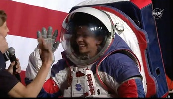 Davis demonstrates the spacesuit's added function of dexterity.