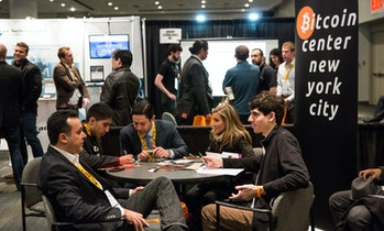 NEW YORK, NY - APRIL 07: People attend a Bitcoin conference on at the Javits Center April 7,2014in New York City. Topics included market places to trade bitcoin, mining hardware to harvest bitcoins and digital wallets to store bitcoins. Bitcoin is one of the most popular of over one hundred digital currencies that have recently come into popularity. (Photo by Andrew Burton/Getty Images)