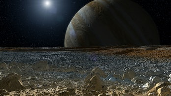 A view of Jupiter from Europa's icy surface.