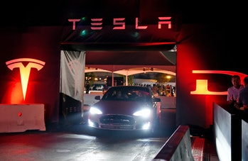 HAWTHORNE CA - OCTOBER 09: Tesla owners take a ride in the new Tesla 'D' model electric sedan after Elon Musk, CEO of Tesla, unveiled the dual engine chassis of the new Tesla 'D' model, a faster and all-wheel-drive version of the Model S electric sedan, at the Hawthorne Airport October 09, 2014 in Hawthorne, California. The D will be able to accelerate to 60 miles per hour in just over 3 seconds. (Photo by Kevork Djansezian/Getty Images)