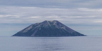 Raikoke as itnormally sits, peacefully, as seen from the Sea ofOkhotsk