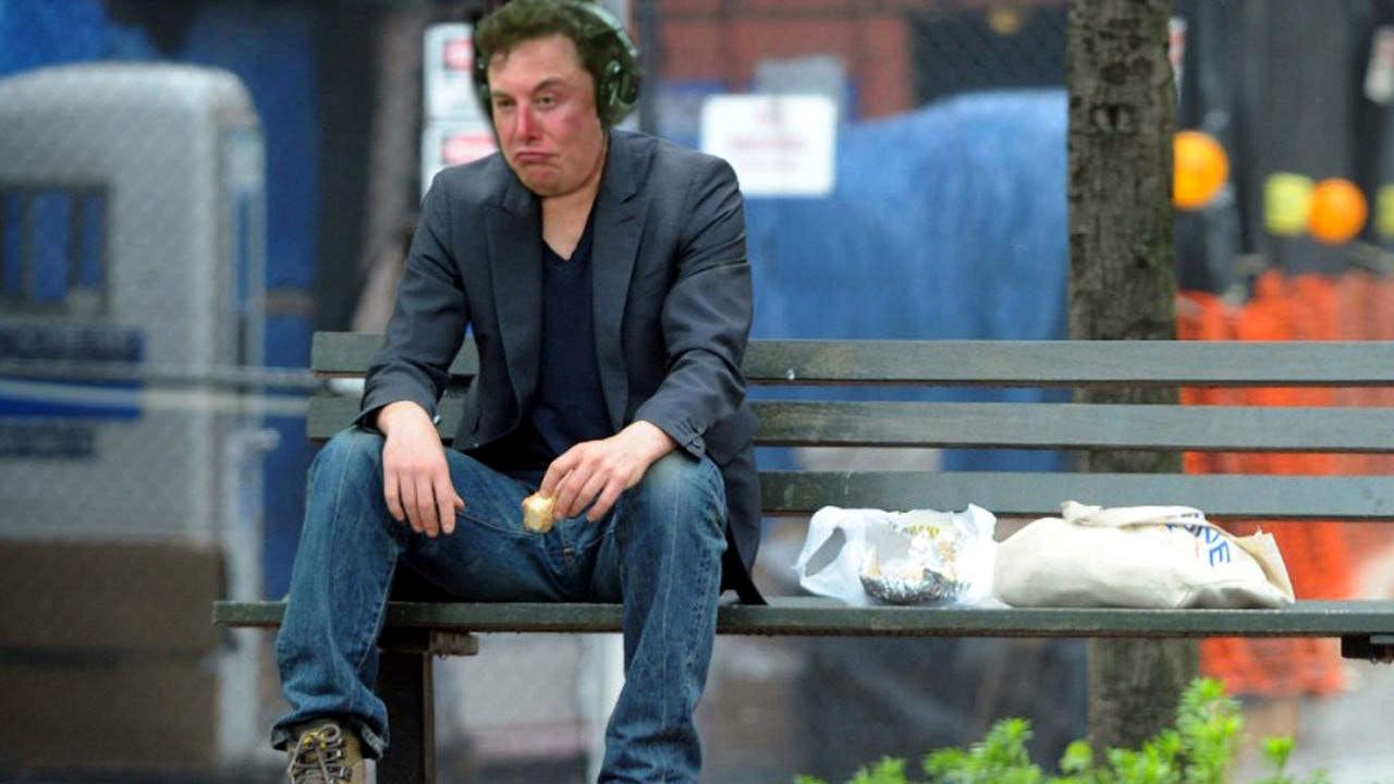 Musk as Keanu Reeves eating a sandwich.