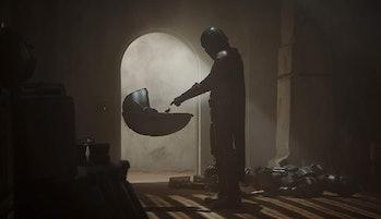 Baby Yoda and The Mandalorian meet in 'The Mandalorian' on Disney Plus