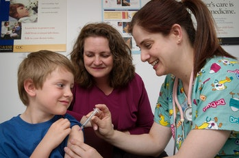 boy receives vaccine