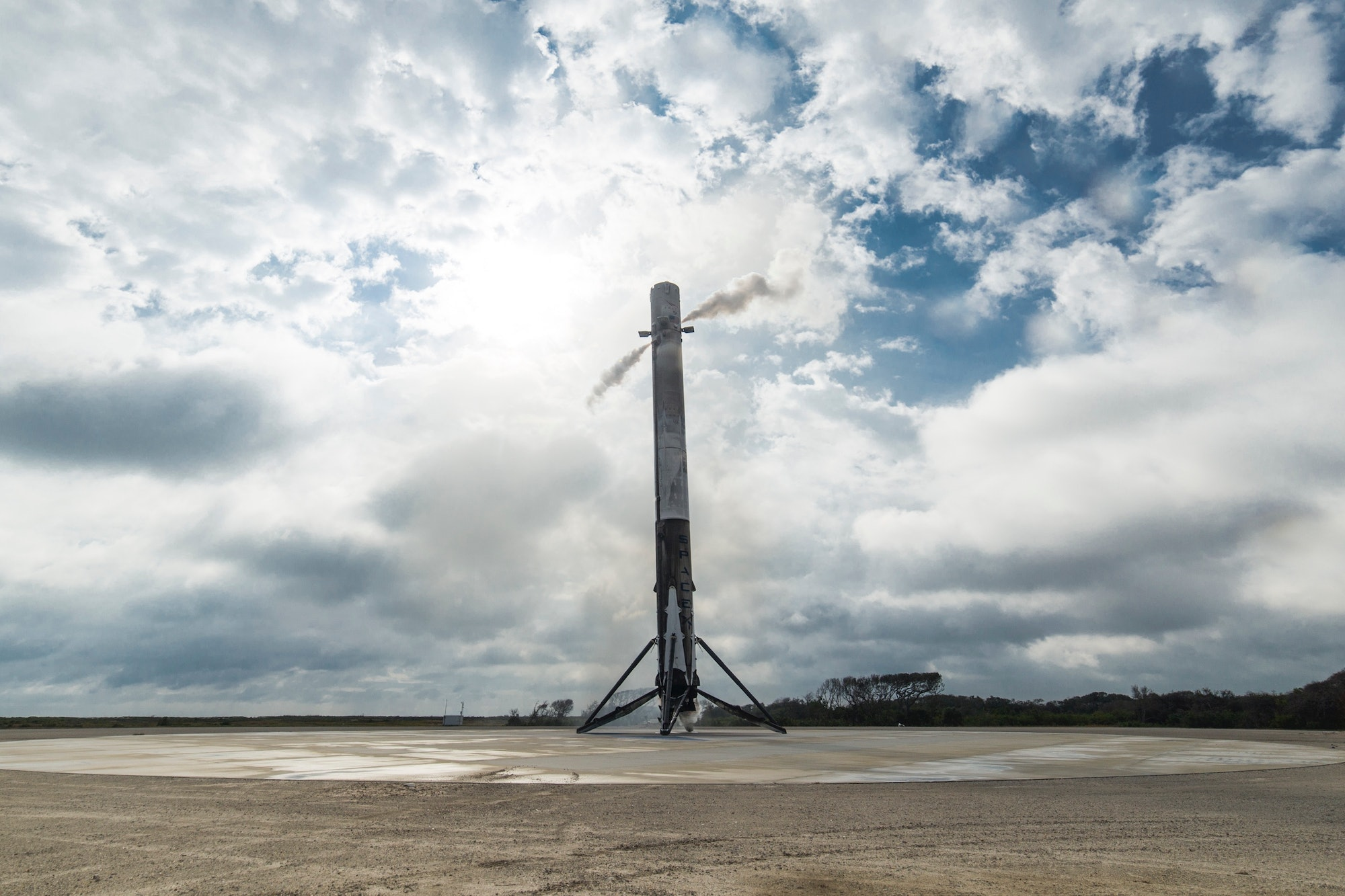 A Falcon 9 first-stage rocket booster back on Earth at the LZ-1 landing pad in February.