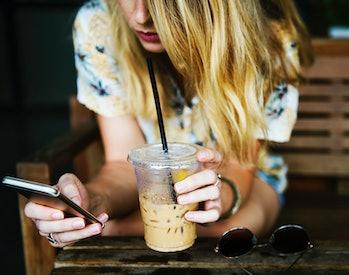 millennials reading news phone