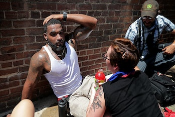 CHARLOTTESVILLE, VA - AUGUST 12: Rescue workers and volunteer medics tend to people who were injured when a car plowed through a crowd of anti-facist counter-demonstrators marching through the downtown shopping district August 12, 2017 in Charlottesville, Virginia. The car plowed through the crowed following the shutdown of the 'Unite the Right' rally by police after white nationalists, neo-Nazis and members of the 'alt-right' and counter-protesters clashed near Lee Park, where a statue of Confederate General Robert E. Lee is slated to be removed. (Photo by Chip Somodevilla/Getty Images)