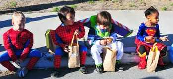 kids with halloween candy