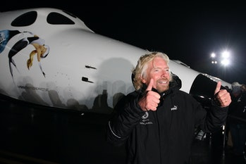 Sir Richard Branson gestures to reporters as Virgin Galactic unveils its new SpaceShipTwo spacecraft at the Mojave Spaceport on December 7, 2009.