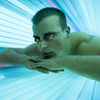 The tanning industry may be targeting neighborhoods with gay men: study