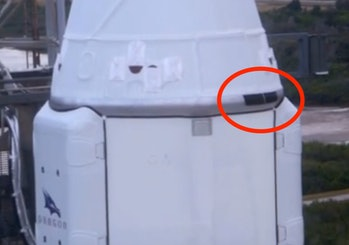 This zoomed-in photograph of the Dragon cargo capsule atop the Falcon 9 rocket on Thursday shows the...