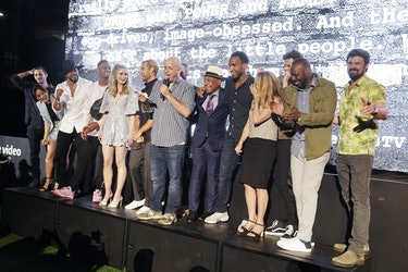 Eric Kripke (center, holding the microphone) with the cast of 'The Boys' at Amazon.