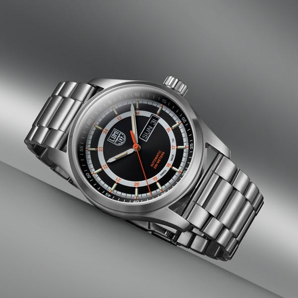 Swiss-built designer watch with stainless steel straps and quartz display