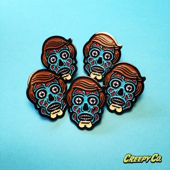 """Creepy Co.'s 'All Consuming Alien"""" pin design based on John Carpenter's 'They Live.'"""