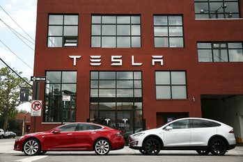 Tesla vehicles sit parked outside of a new Tesla showroom and service center in Red Hook, Brooklyn on July 5,2016in New York City. The electric car company and its CEO and founder Elon Musk have come under increasing scrutiny following a crash of one of its electric cars while using the controversial autopilot service. Joshua Brown crashed and died in Florida on May 7 in a Tesla car that was operating on autopilot, which means that Brown's hands were not on the steering wheel.