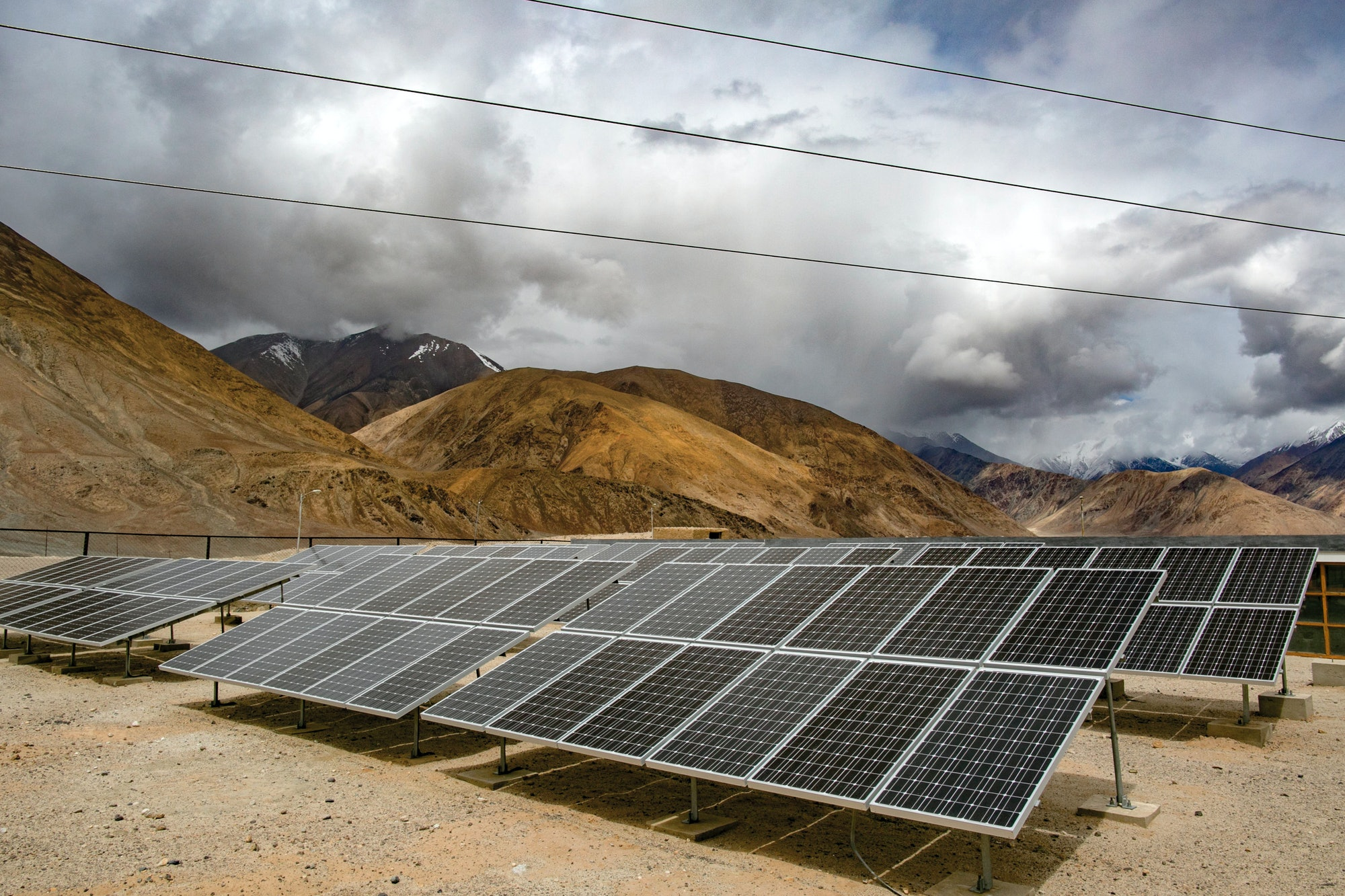 LADAKH, INDIA - JUNE 14: Solar panels are seen inYaratvillage on June 14,2017in Ladakh, India. The cold desert of Ladakh has been known as the roof of the world and reportedly a region with huge potential in tapping the solar energy with its vast patches of barren land surrounded by mountains. As U.S. President Donald Trump announced plans to withdraw from the Paris agreement on climate change, Indian Prime Minister Narendra Modi said two days later that India was 'part of the world's shared heritage' and that the country would 'continue working... above and beyond the Paris accord'. At the Leh district, located at the altitude of 11,562 feet, the Ladakh Renewable Energy Development Agency is currently working on renewable energy, including solar, projects throughout Ladakh despite challenges at the mountainous terrain and sees the opportunity to earn revenue by exporting electricity to demand centers in North India while its residence simply hope to attain energy independence. Based on reports, China and India will be the biggest recipients for renewables energy with the highest power-generating capacity by 2040. India had planned to build the world's largest solar power project in Ladakh back in 2014 but the project was later announced this year to be placed it on hold due to the huge costsonthe transmission system while the country continues by focusing on smaller projects instead. (Photo by Allison Joyce/Getty Images)