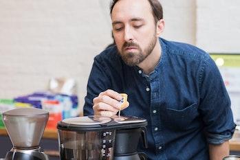 Matt Banbury measures the temperature in a Bonavita brew bed.