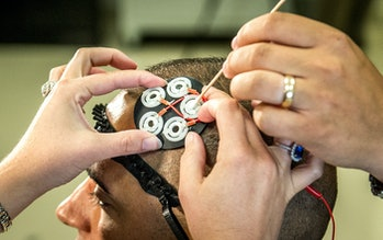 Electrodes to administer directed electrical brain stimulation are placed on the head of a test subj...