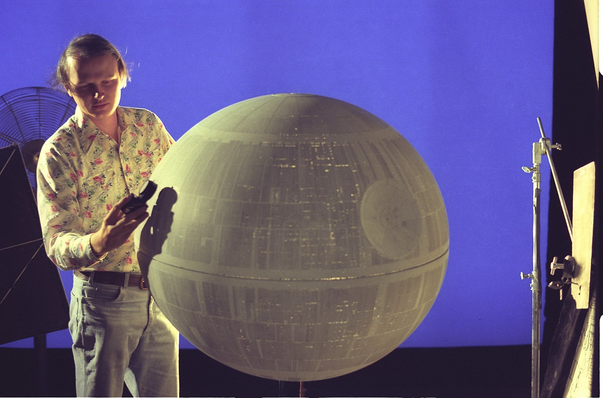 """ILM visual effects supervisor Dennis Muren with the miniature Death Star built for """"A New Hope."""""""