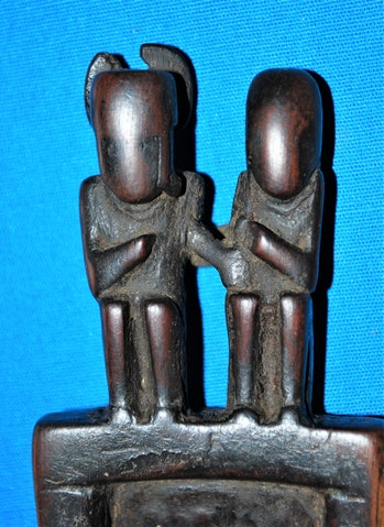 These figures are carved into the end of a tray, which was most likely used to consume a psychoactive snuff.