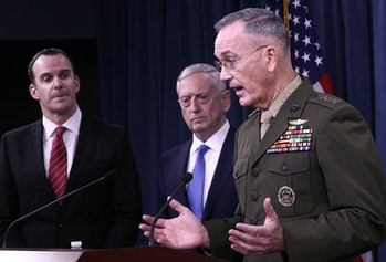 ARLINGTON, VA - MAY 19: Chairman of the Joint Chiefs of Staff Marine Gen. Joseph F. Dunford Jr (R), U.S. Secretary of Defense Jim Mattis (C) and Special Presidential Envoy for the Global Coalition to Counter ISIS Brett McGurk (L) answer questions during a Pentagon briefing May 19,2017in Arlington, Virginia. Mattis, Dunford, and McGurk briefed members of the press on the status of U.S. President Donald Trump's campaign to defeat ISIS. (Photo by Win McNamee/Getty Images)