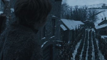 A young boy looks at Daenerys and Jon's army as they arrive in Winterfell on 'Game of Thrones'